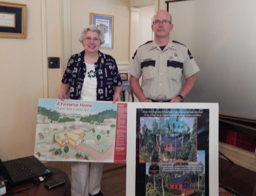 From left, are Sharon Ann Paradis, garden club president, and Ranger Kent Nelson from the Maine State Forestry Department.