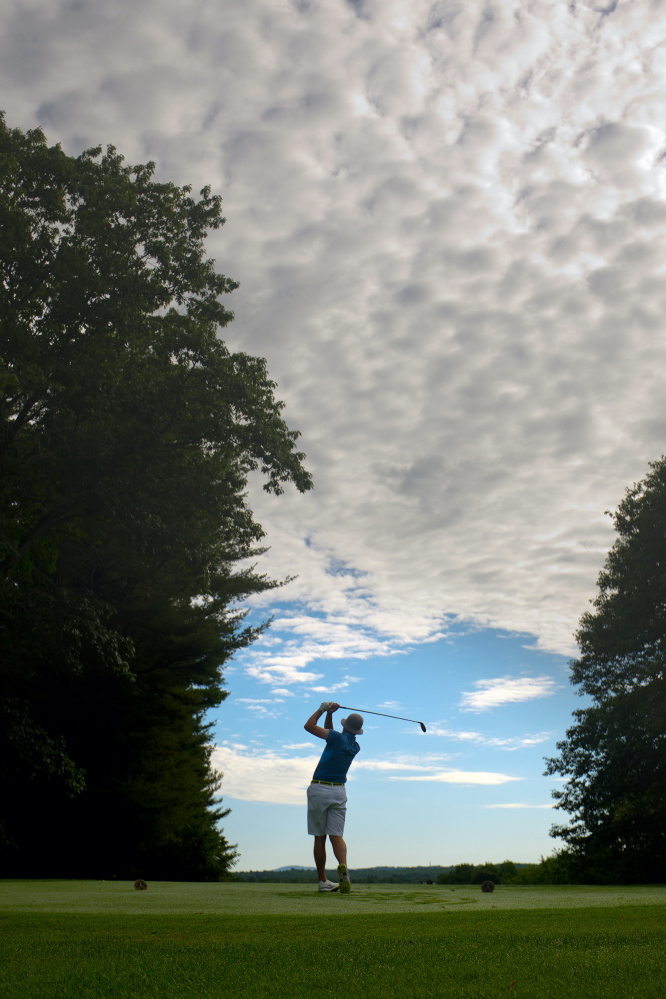 Andrew Slattery of Minot tees off on the 10th hole while competing against Jeff Cole of York in the Maine Match Play Championship at Martindale Country Club in Auburn on Thursday.