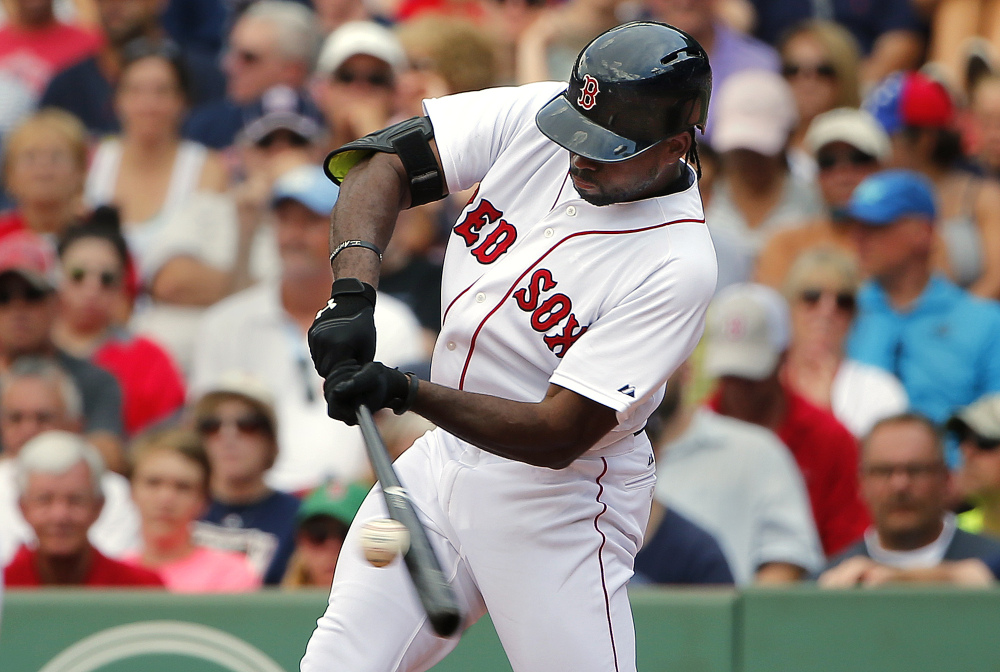 Boston Red Sox's Jackie Bradley Jr. connects on a two-run double against the Seattle Mariners during the seventh inning of Saturday's game at Fenway Park in Boston. Bradley Jr. finished with two home runs, three doubles and seven RBIs as the Red Sox rolled the Mariners 22-10.