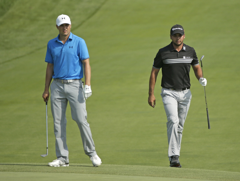 Jordan Spieth, left, and Jason Day, right, of Australia, walk to the ninth green during the fourth round of the PGA Championship golf tournament Sunday at Whistling Straits in Haven, Wis.