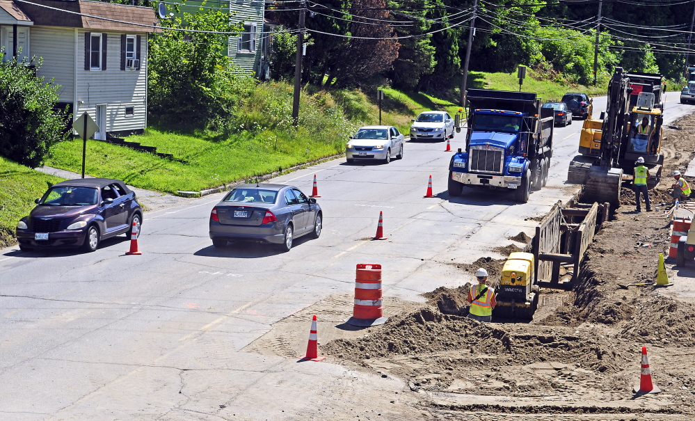Vehicles drive past College Carryout, which is still open in the construction zone, on Mount Vernon Avenue on Friday in Augusta.