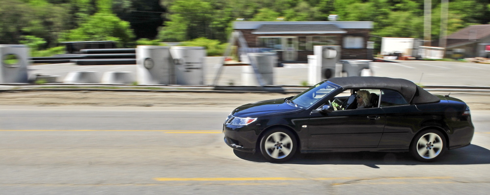 A vehicle drives through the construction zone along Mount Vernon Avenue on Friday in Augusta.