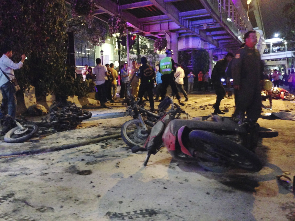 Motorcycles are strewn about after an explosion in Bangkok, Monday.