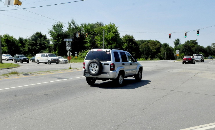 Traffic moves at the busy intersection of Carter Memorial Drive and U.S. Route 201 in Winslow on Monday. The state Department of Transportation plans next year to update the lights at five major intersections on Carter Memorial Drive so that the lights sync. There will be a public hearing on the plan Sept. 3.