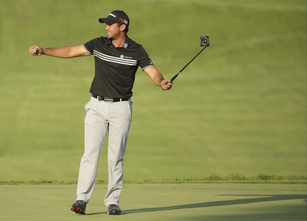 Jason Day celebrates after winning the PGA Championship on Sunday at Whistling Straits in Haven, Wis.