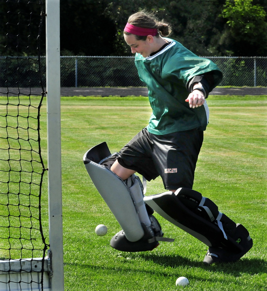 Winslow High School field hockey goalie Delaney Wood does drills during practice Monday.
