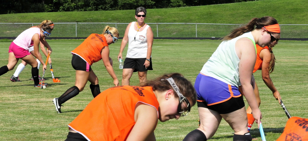 Winslow field hockey head coach Mary Beth Bourgoin leads the team in practice Monday on Monday in Winslow.