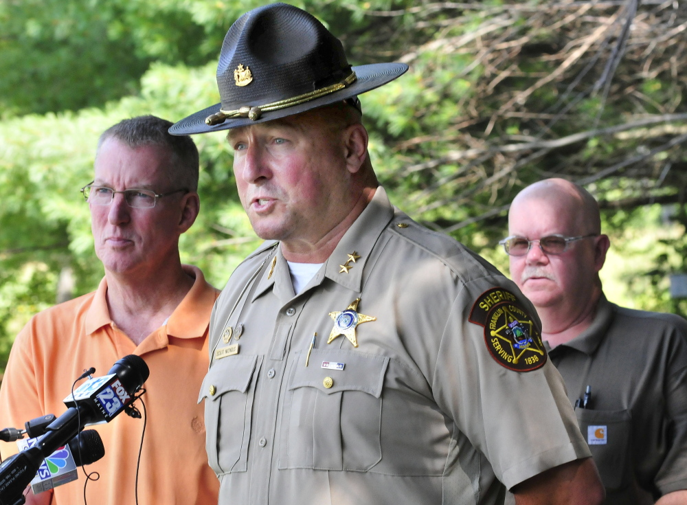 Staff photo by David Leaming Franklin County Sheriff Scott Nichols, center, is flanked by Sgt. Ken Grimes, left, and inspector Kenneth MacMaster of the State Fire Marshal's Office, during a press conference regarding arson suspect arrests on Tuesday at the Farmington County Sheriff's Office.