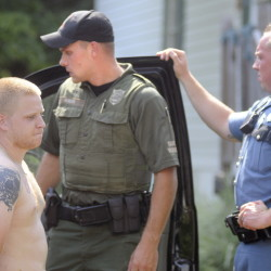 District Game Warden Ethan Buuck, center, and Maine State Trooper Dane Wing arrest Brandon Draveau outside a trailer in Mt. Vernon on Tuesday. Draveau, 22, allegedly fled from Buuck on a dirt bike before being apprehended by the wardens and troopers.