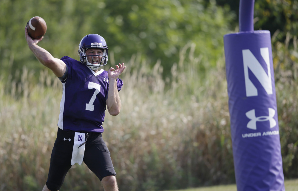 Northwestern football player Matt Alvita throws during practice at the University of Wisconsin-Parkside campus on Monday, in Kenosha, Wi. The National Labor Relations Board on Monday overturned a historic ruling that gave Northwestern University football players the go-ahead to form the nation's first college athletes' union, saying the prospect of union and non-union teams could throw off the competitive balance in college football.