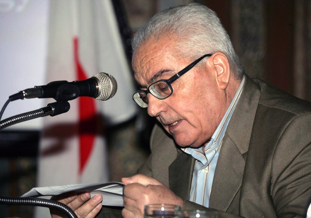 In this undated photo released Tuesday by the Syrian official news agency SANA, one of  Syria's most prominent antiquities scholars, Khaled al-Asaad, speaks in Syria. Islamic State militants beheaded al-Asaad in the ancient town of Palmyra, Syria, then strapped his body to one of the town's Roman columns, Syrian state media and an activist group said Wednesday.