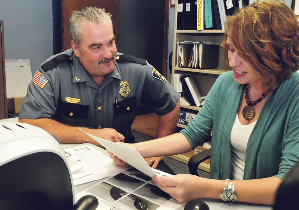 Skowhegan Police Deputy Chief Donald Bolduc speaks with Administrative Assistant Erin Brown on Thursday. Bolduc, who has been interim chief for the past month, will officially be named police chief Tuesday.
