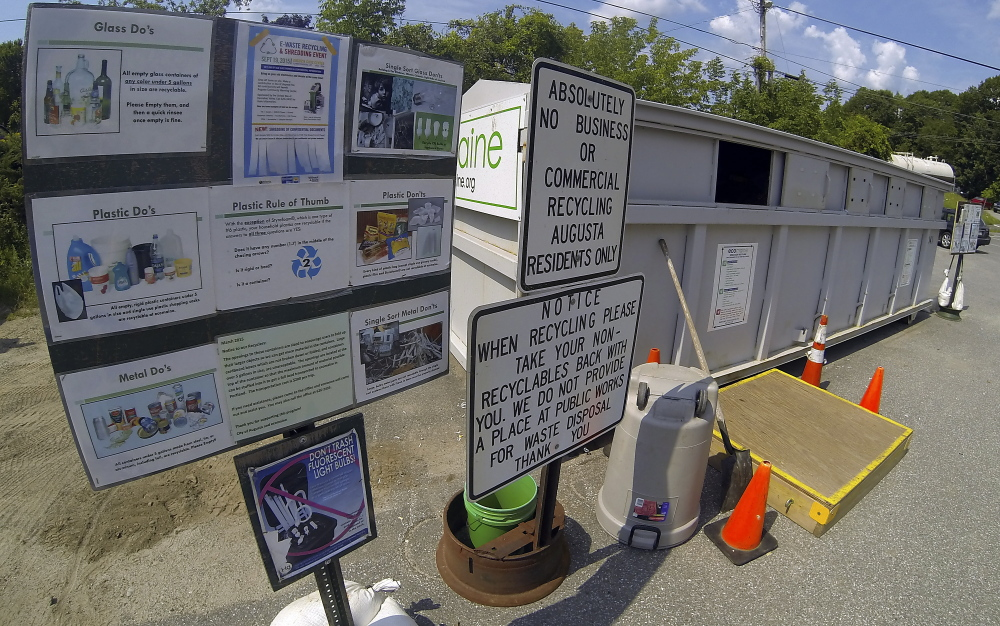 The outside of a recycling container is seen Tuesday at the John Charest Public Works Facility on North Street in Augusta.