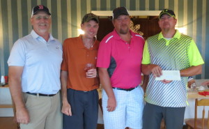 Men's A Division— First place winners, from left, are Jeff Richards, Noel Dolbier, Larry Washington and Erin Washington.