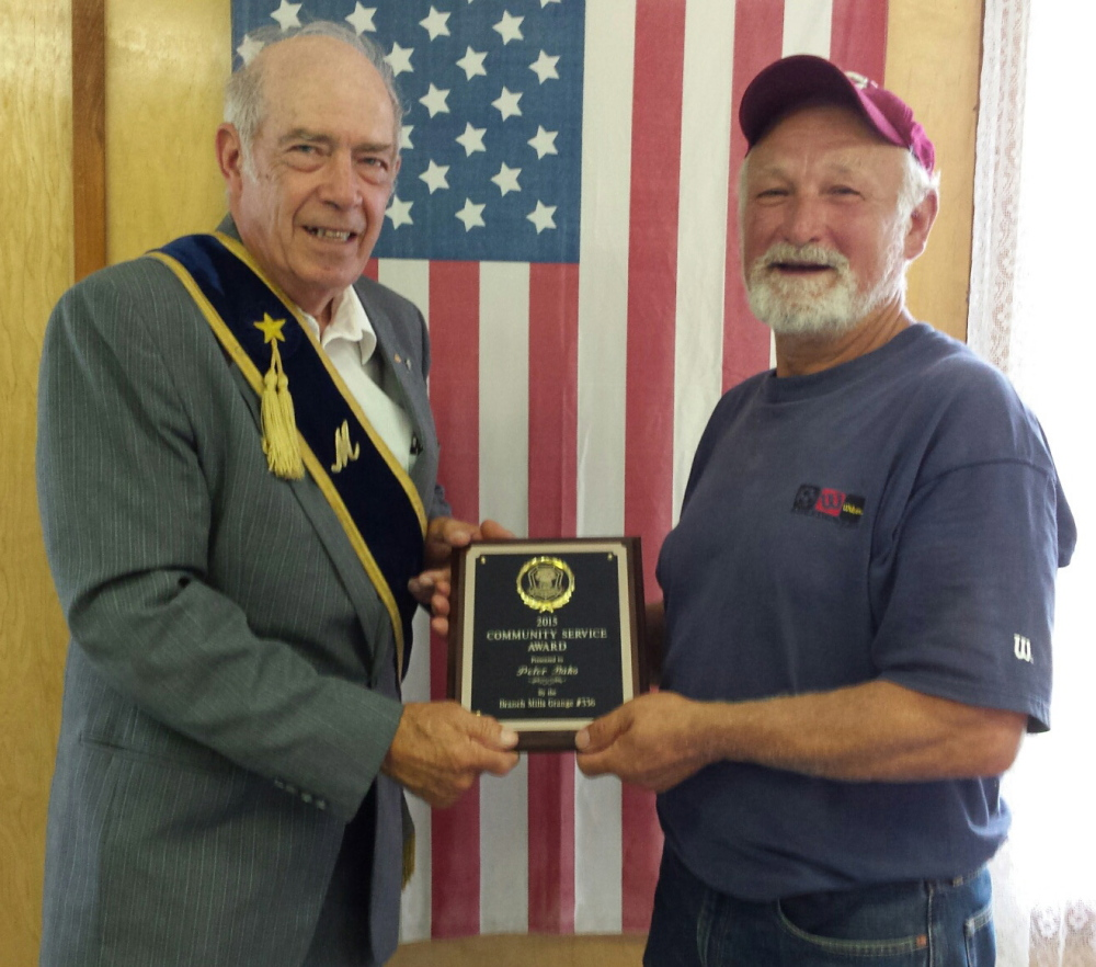 Grange Community Service Award recently was presented to Peter Bako by Branch Mills Grange 336 Master David Parkman. Bako was chosen for this year's award to thank him for the time, labor and skill he has donated to help the Grange.