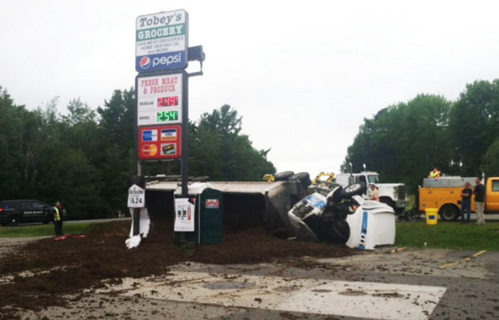 Jeremy Bamford, of Fayette, is expected to be charged with imprudent speed and failure to maintain control after his truck fully loaded with chicken manure tipped over, dumping the load in the parking lot of Tobey's Grocery on Route 3 in South China on Friday.