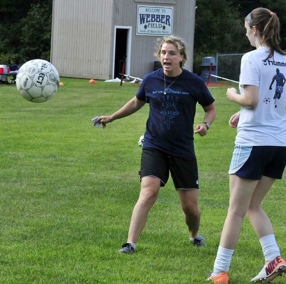 Staff photo by David Leaming   New Waterville girls soccer coach Christine Bright leads a drill during practice Thursday at Webber Field.