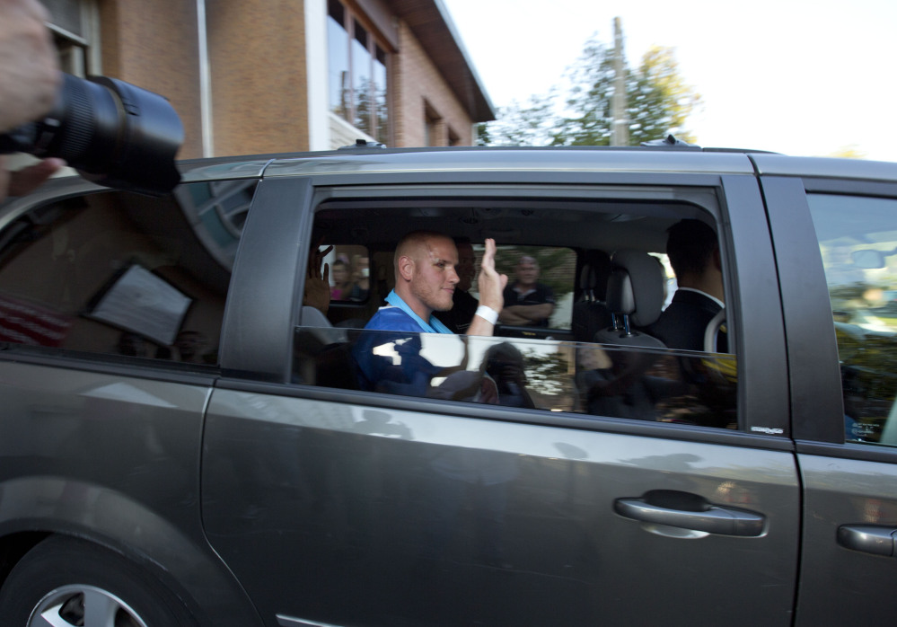 Spencer Stone waves as he leaves the police station in Arras, northern France, on Saturday. Stone is one of the passengers credited with subduing a gunman.