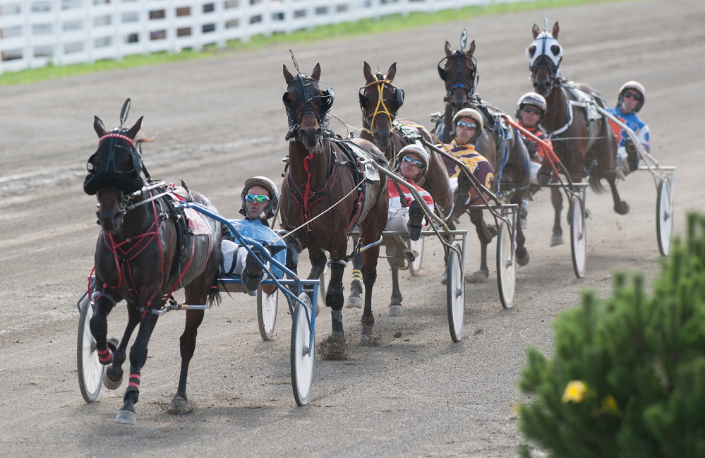 Kevin Bennett photo   The field of five horses cross the half mile marker during the Walter H. Hight Invitational on Saturday at the Skowhegan Fairgrounds. Heath Campbell riding Wheelaway won the race.