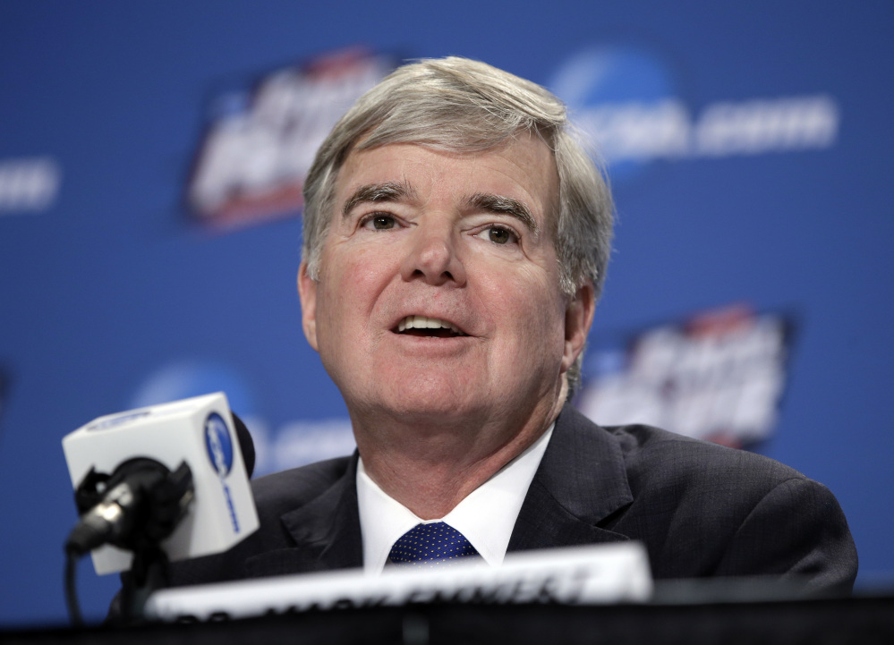 AP photo   In this April 2, 2015, file photo, NCAA President Mark Emmert answers questions during a news conference at the Final Four college basketball tournament in Indianapolis. Though blocked from forming their own player unions, lawsuits filed by college athletes are still challenging longstanding NCAA rules capping pay.