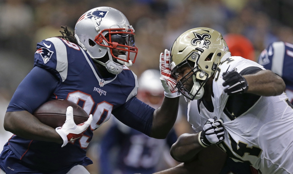 AP photo   New England Patriots running back Travaris Cadet is stopped on a carry by New Orleans Saints defensive end Cameron Jordan in the first half of a preseason game in New Orleans on Saturda.