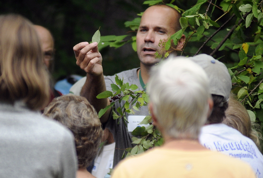 Ecologist Eric Doucette leads a tour at the Kennebec Land Trust annual meeting on Sunday in Fayette.