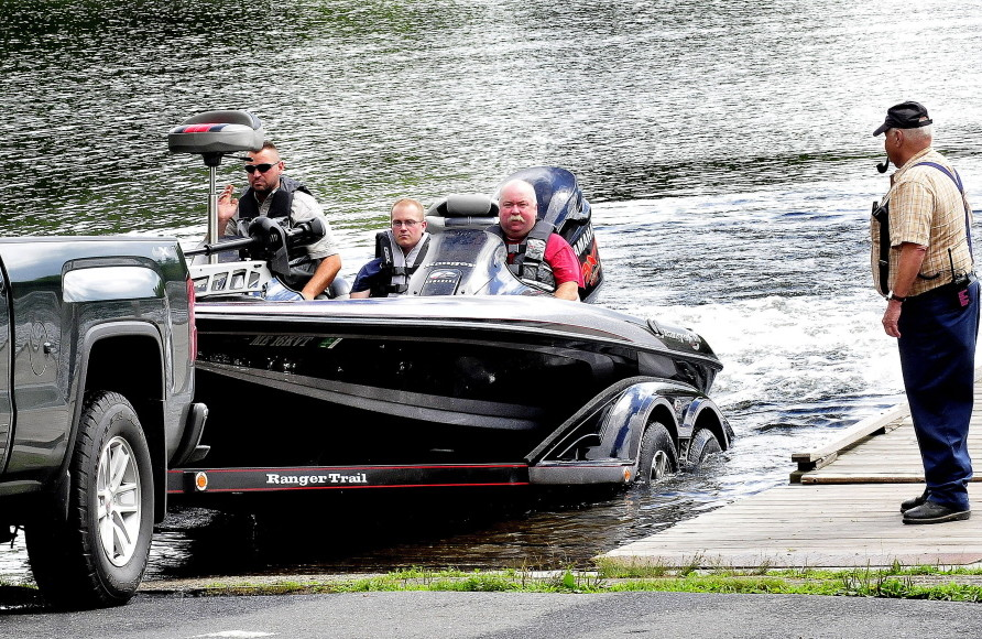 Oakland fire department first responders return to the Oakland Boat Landing on Messalonskee Lake Monday after the body of a local man was recovered from the lake.
