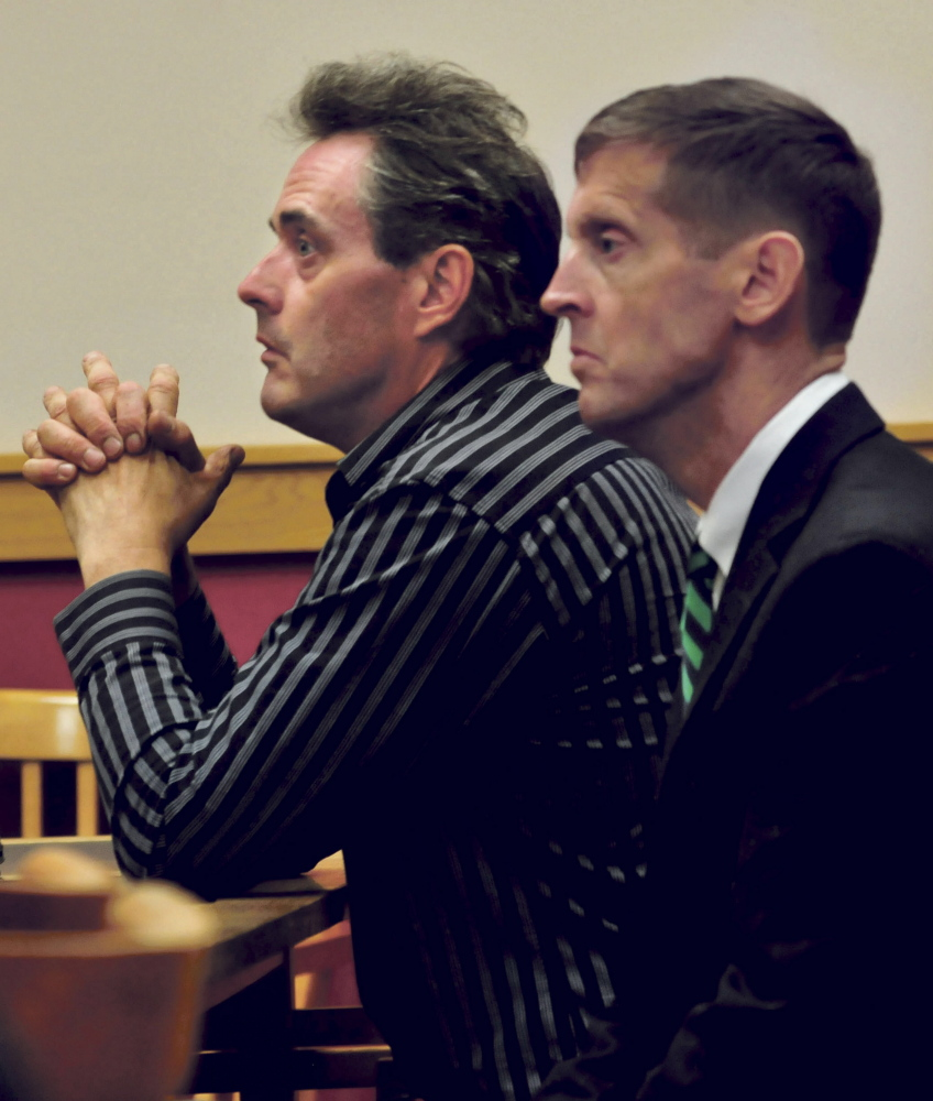Robert Dale, left, and his attorney Walter McKee are seen during a hearing in Skowhegan District Court on Monday.