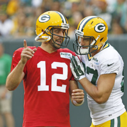 AP photo   In this Aug. 8 photo, Green Bay Packers quarterback Aaron Rodgers, left, and Jordy Nelson talk during training camp practice in Green Bay, Wis. Few receivers are as important to their teams as Nelson is to Aaron Rodgers and Green Bay. Nelson injured his left knee in a preseason game against the Pittsburgh Steelers on Sunday.