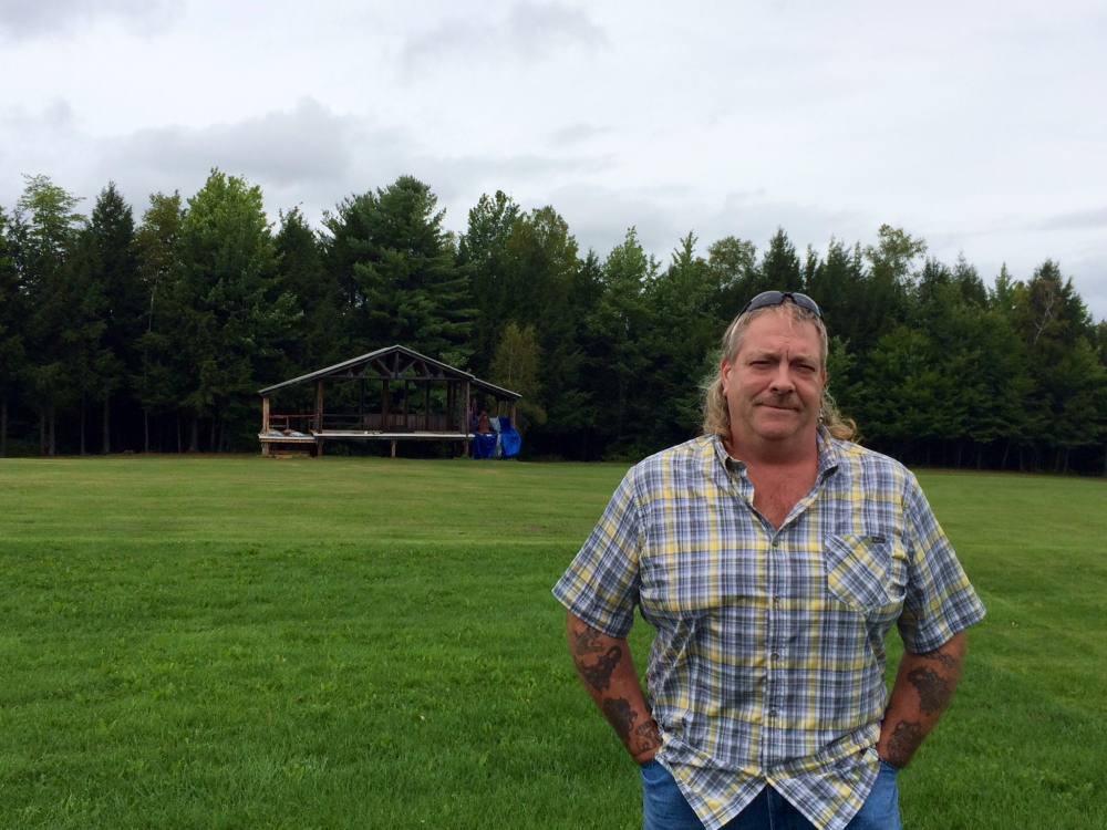 Tim Rogers, ninth-generation owner of Last Breath Farm, stands in front of what will be the main stage at the Great North Music and Arts Festival.