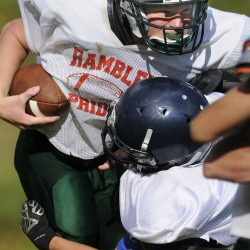 Staff photo by Andy Molloy   Winthrop High School quarterback Matt Ingram runs through a tackle during a scrimmage against Lincoln on Monday.