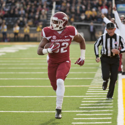 AP photo   In this Nov. 28, 2014, file photo, Arkansas running back Jonathan Williams runs alone down the sideline as he scores on a 23-yard reception during the first quarter of a game against Missouri in Columbia, Mo. The 18th-ranked Razorbacks lost half their dynamic duo at running back when Williams injured his left foot during an Aug. 15 scrimmage.