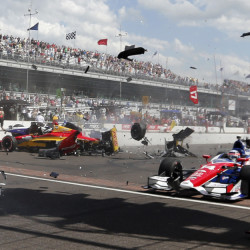 In this May 2014 file photo, Sebastian Saavedra, left, is hit by Mikhail Aleshin as Takuma Sato, right, drives past on the start of the inaugural Grand Prix of Indianapolis at the Indianapolis Motor Speedway. The IndyCar Series has bounced from one problem to another all season as it scrambles for viewers and new fans. It heads into the season finale this weekend after suffering the worst possible blow: The death of a driver, with Justin Wilson dead at 37 from injuries suffered in a crash.