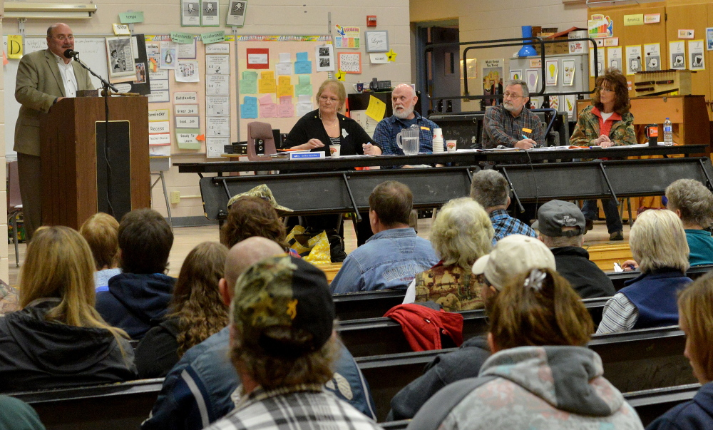 Susan Anneley, town clerk, left, and Maynard Webster, Forrest Bonney and Lorna Nichols, far right, sit at the table during the annual Town Meeting at the New Sharon Elementary School on March 7. Anneley, elected to her post Feb. 28, resigned earlier this month and residents will vote on making the post an appointed one at a special town meeting Wednesday.