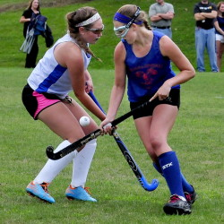 Staff photo by David Leaming   Lawrence's Lauren Lambert, left, and Messalonskee's Emily Hogan battle for possession during a preseason game Tuesday in Fairfield.