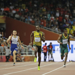 Usain Bolt, middle, competes in a men's 200m semifinal at the World Athletics Championships at the Bird's Nest stadium in Beijing on Wednesday.