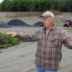 Chairman of the Belgrade Board of Selectpersons Ernie Rice, standing in May on the site where town officials propose to build a new Town office, discusses the construction plan.