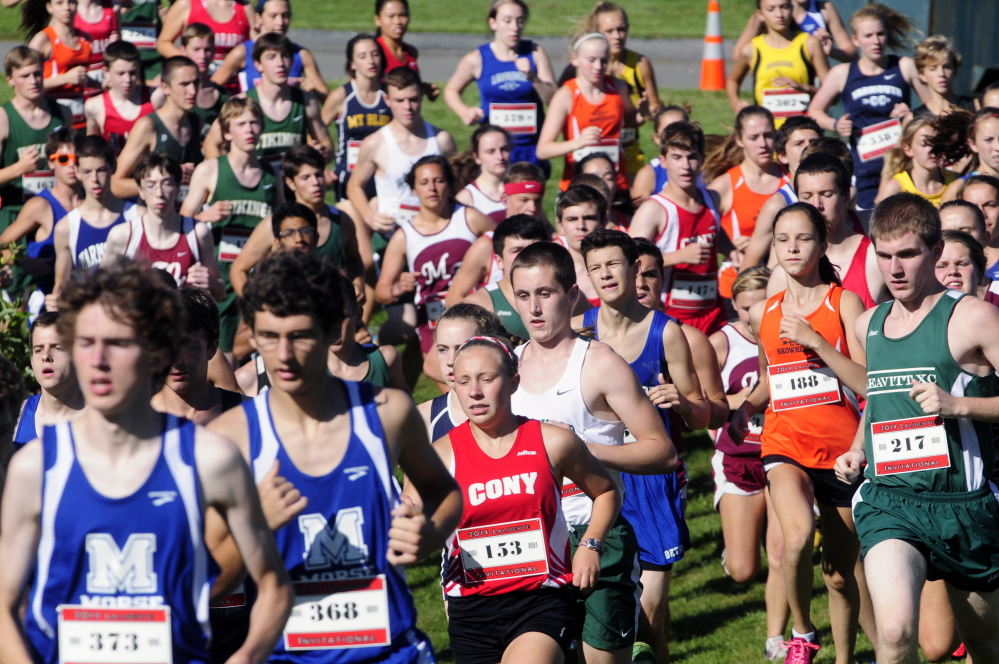 The boys and girls teams run the 2.4-mile course together during the 15th annual Laliberte Invitational last August at Cony High School in Augusta.