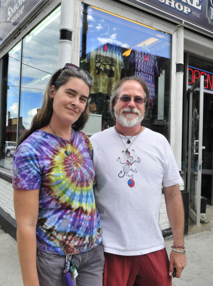 Angel and Jim O'Keeffe outside their Happy Trails store in downtown Waterville on Thursday. Colby College students will paint a mural on the Temple Street side of their building later this month, and build a temporary park on the corner Thursday, as part of freshman orientation.
