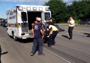 James Bolduc, of Fairfield, is loaded into an ambulance on College Avenue in Waterville Thursday afternoon. Bolduc is in critical condition at Maine Medical Center in Portland after crashing his Harley-Davidson in a chain-reaction accident.