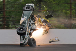 In this May 17 file photo, Ed Carpenter hits the wall in the second turn during practice before qualifications for the Indianapolis 500 at Indianapolis Motor Speedway. The IndyCar Series has bounced from one problem to another all season as it scrambles for viewers and new fans. It heads into the season finale this weekend after suffering the worst possible blow: The death of a driver, with Justin Wilson dead at 37 from injuries suffered in a crash.
