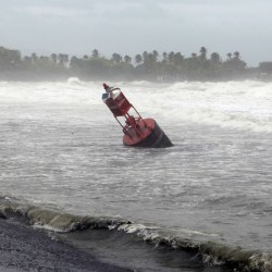 A large navigation buoy hit by strong winds and waves, floats near the coast, as Tropical Storm Erika moves away from the area in Guayama, Puerto Rico, Friday, Aug. 28, 2015. The storm was expected to dump up to 8 inches of rain across the drought-stricken northern Caribbean as it carved a path toward the U.S. (AP Photo/Ricardo Arduengo)