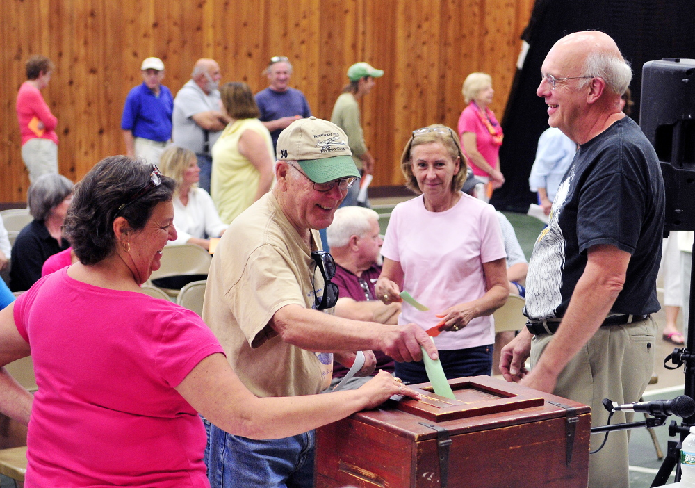 Voters cast secret ballots Saturday on plans to build a new Town Office during the a special town meeting in the Belgrade Community Center for All Seasons.