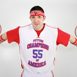 Jason Gibbons spins two balls with his hands upside down. Gibbons played with the Harlem Rockets for 10 years and also with the Harlen Globetrotters Legends team.