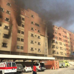 Smoke billows from a residential complex in Khobar, Saudi Arabia, on Sunday. A fire broke out at the residential complex used by the state oil giant Saudi Aramco.