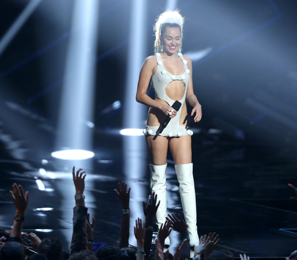 "Miley Cyrus appears at the MTV Video Music Awards on Sunday. Cyrus had criticized Nicki Minaj for being a poor sport and for a ""war"" with Taylor Swift."