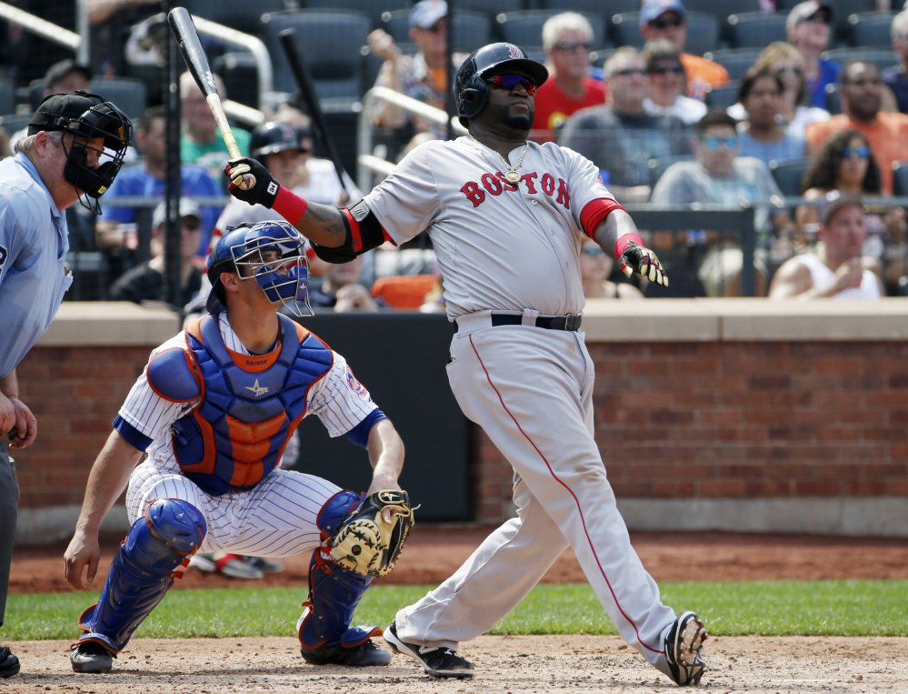 New York Mets catcher Anthony Recker, center, watches as Boston Red Sox's David Ortiz, right, hits a sixth-inning two-run home run in an interleague baseball game in New York, Sunday, Aug. 30, 2015. (AP Photo/Kathy Willens)