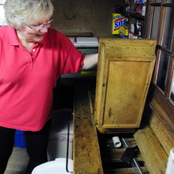 "Tricia Harwood opens an old unused ice box in The Harwood Camp that will be on the ""Homes of Wayne Tour."" The family used to harvest ice from nearby Androscoggin Lake to keep things cold in the summer, but they've got an electric refrigerator now."