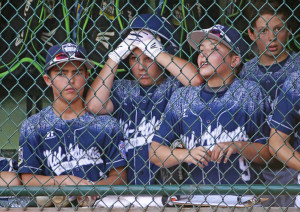 Players in the Lewisberry, Pennsylvania dugout watch in the sixth inning against Japan in the Little League World Series championship Sunday in South Williamsport, Pa. Japan won 18-11.