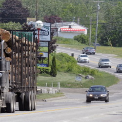 Vehicles travel on U.S. Route 202 in Manchester where the Maine Department of Transportation is adding a center turn lane in hopes of reducing accidents.
